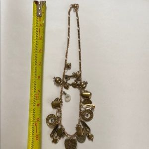 Gold tone charm necklace.